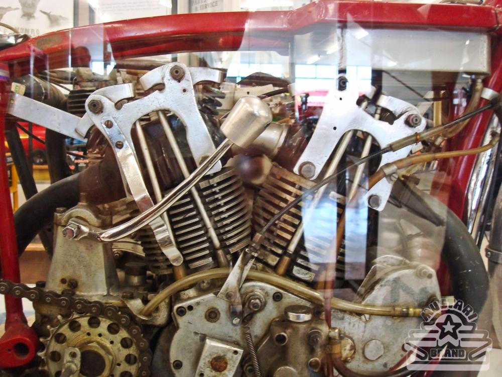 Burt's original race bike motor in frame and behind glass